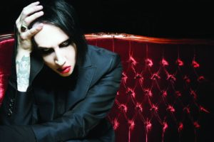 Marilyn Manson red couch, Marilyn Manson, Brian Hugh Warner, Paul Wiley, Gil Sharone,Twiggy Ramirez, We Know Where You Fucking Live, Say10, Heaven Upside Down, Loma Vista Recordings, Caroline International, Antichrist Superstar, Trent Reznor, Tyler Bates, Mr. Superstar, Born Villain, Flowers of Evil, The Pale Emperor, Marilyn Manson new song, Marilyn Manson new album, Revelation #12, Tattooed in Reverse, We Know Where You Fucking Live, Say10, Kill4Me, Saturnalia, Je$u$ Cri$i$, Blood Honey, Heaven Upside Down, Treats of Romance, KILL4ME, Industrial metal, Alternative metal, Hard rock, Gothic rock, Gothic metal, antichrist, sickandsound, Marylin Manson new album review, Heaven upside Down review, Artists, Albums