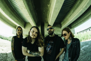 Of Mice & Men article preview, Of Mice & Men, metalcore, nu metalcore, metal, Of Mice & Men new album, Of Mice & Men new song review, Listen to Of Mice & Men, Aaron Pauley, Phil Manansala, Alan Ashby, Valentino Arteaga, Austin Carlile, The Flood, Restoring Force, Cold World, Defy, Rise Records, Instincts, Back To Me, Sunflower, Unbreakable, Vertigo, Money, How Will You Live, On The Inside, Warzone, Forever YDG'n, If We Were Ghosts, sickandsound, artists, new release for Of Mice & Man, OM&M, Of Mice & Men Back To Me, Of Mice & Men Unbreakable, Of Mice & Men Warzone, Of Mice & Men Defy, listen to Of Mice & Men latest song, stream Of Mice & Men latest song Defy